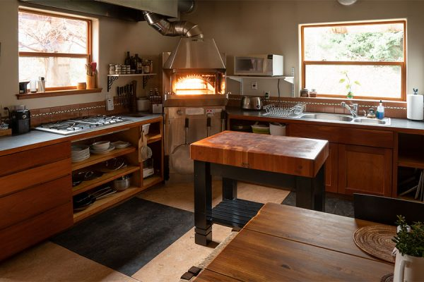 Farmhouse Suite kitchen with Wood Stone oven